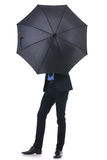 Business man hides his face with umbrella Royalty Free Stock Image