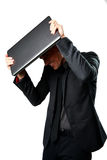 Business man hides under the laptop Stock Image