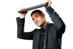 Business man hides under the laptop Stock Photos