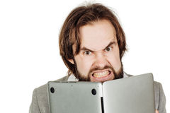 Business man hiding behind his laptop computer in his hands. emo Royalty Free Stock Images