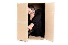 Business man hiding in a carton box Stock Photos