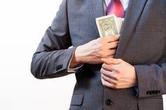 Business man hiding money in jacket pocket Royalty Free Stock Photos