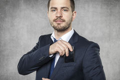 Business man hiding a phone. Handsome business man hiding a phone Stock Images
