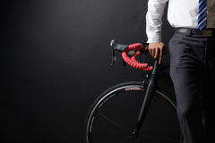 Business man and his bicycle, concept bike go to work Royalty Free Stock Photo