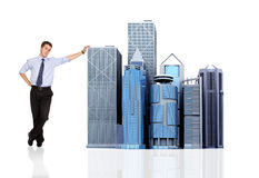 Business man and his corporate empire Stock Photos