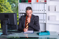 Business man at his desk is amazed Stock Images