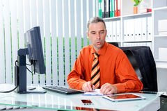 Business man at his desk looking stressed Stock Photos