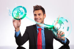 Business man on his desk making choices Royalty Free Stock Images