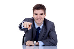 Business man at his desk pointing Stock Image