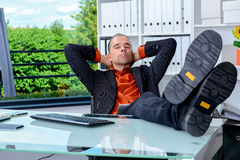 Business man at his desk is relaxing Royalty Free Stock Images