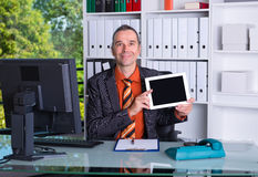 Business man at his desk showing tablet PC Stock Photography