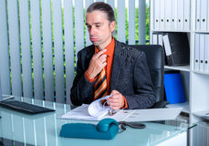 Business man at his desk in summerly hot office Stock Images
