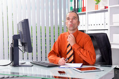Business man at his desk in summerly hot office Royalty Free Stock Image
