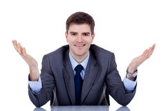 Business man at his desk welcoming Stock Photos