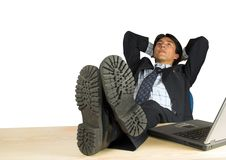 Business man with his feet up Stock Photography