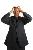 Business man with his hands on head due to failure Royalty Free Stock Images