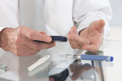 Business man in his office  with  onset diabetes measuring blood Royalty Free Stock Images