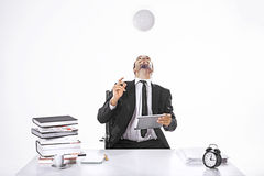 Business man hitting the ball with head holding an ipad Stock Images