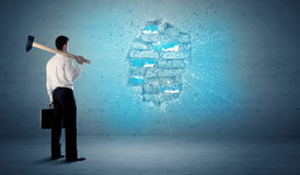 Business man hitting brick wall with huge hammer Royalty Free Stock Photography