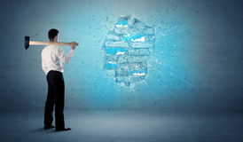 Business man hitting brick wall with huge hammer Royalty Free Stock Images