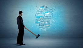 Business man hitting brick wall with huge hammer Stock Images