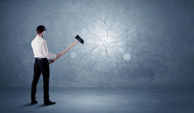Business man hitting wall with a hammer Stock Images