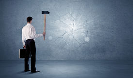 Business man hitting wall with a hammer Royalty Free Stock Photo