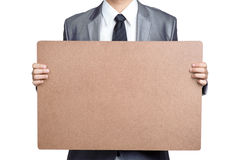 Business man Hold blank placard isolated. Business man Hold blank placard in isolated Stock Photo