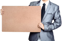 Business man Hold blank placard isolated. Business man Hold blank placard in isolated Royalty Free Stock Photos