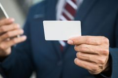 Business man hold card stock photography