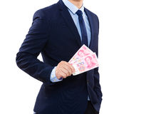Business man hold China money Stock Image