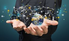 Close up of businessman holding digital globe in royalty free stock images