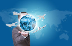 Business man hold Earth with airplanes in hand Stock Images