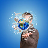 Business man hold Earth with buildings. Airplane Royalty Free Stock Images