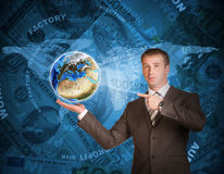 Business man hold Earth. World map and money on Stock Images
