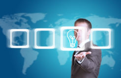 Business man hold frame with bulb in hand Stock Image