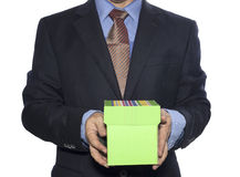 Business man hold on gift box Stock Photos