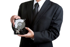 Business man hold harddisk in isolated Stock Photography