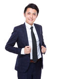 Business man hold with his collar Royalty Free Stock Photos