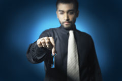 Business man hold key Royalty Free Stock Images