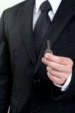 Business man hold key in isolated Stock Image