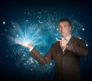 Business man hold magic light in hand Stock Images
