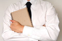 Business man hold note pad and pen Stock Images