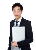 Business man hold with notebook computer Stock Photo