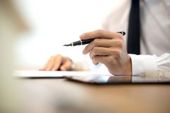 Business man hold pen on the air Royalty Free Stock Photos