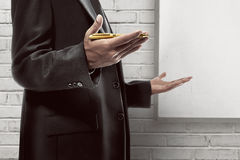 Business man hold pen Stock Photography