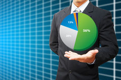 Business man Hold pie chart and table background Royalty Free Stock Photos