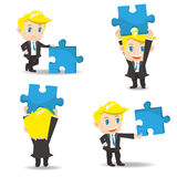 Business man hold puzzle Stock Photo