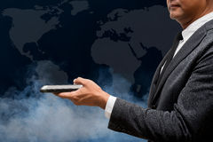 Business man hold smart phone with wolrd map. Business man hold smart phone with a wolrd map Stock Photos
