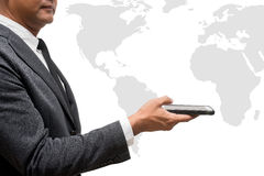Business man hold smart phone with world map Stock Images